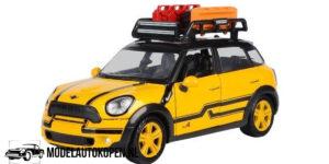 Mini Cooper S Countryman + Roofrack (Geel) (16 cm) 1/24 Motor Max